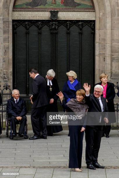 German President FrankWalter Steinmeier and his wife Elke Buedenbender wave as they wait together with German Chancellor Angela Merkel the President...