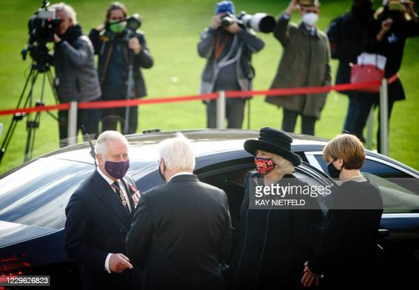 German President Frank-Walter Steinmeier and his wife Elke Buedenbender welcome Britain's Prince Charles, Prince of Wales and Camilla, Duchess of...