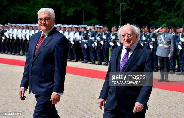 German President FrankWalter Steinmeier and Ireland's President Michael D Higgins inspect a military honor guard at the presidential Bellevue Palace...