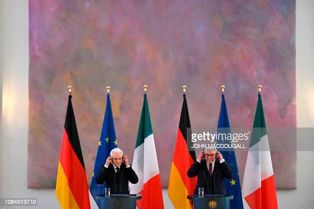 German President FrankWalter Steinmeier and Italy's President Sergio Mattarella adjust their headsets as they give a press conference during a visit...
