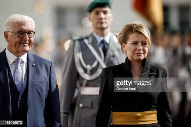German President FrankWalter Steinmeier and new Slovak President Zuzana Caputova review a guard of honor upon Caputova's arrival at Schloss Bellevue...
