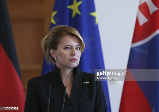 German President FrankWalter Steinmeier and President of Slovakia Zuzana Caputovahold a press conference after their meeting at Schloss Bellevue on...