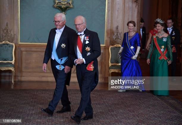 German President Frank-Walter Steinmeier and Sweden's King Carl Gustaf followed by Steinmeier's wife Elke Buedenbender and Queen Silvia arrive for a...