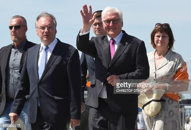 German President FrankWalter Steinmeier and the Prime minister of Saxony Anhalt Reiner Haseloff arrive for the final mass of the Kirchentag festival...