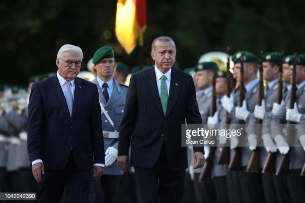 German President Frank-Walter Steinmeier and Turkish President Recep Tayyip Erdogan review a guard of honor upon Erdogan's arrival at Schloss...