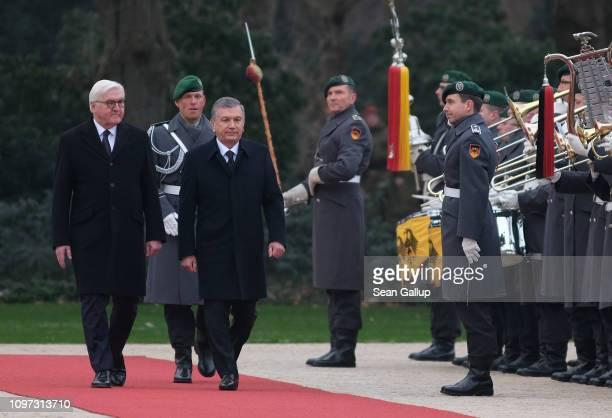 German President FrankWalter Steinmeier and Uzbek President Shavkat Mirziyoyev review a guard of honor upon Mirziyoyev's arrival at Schloss Bellevue...