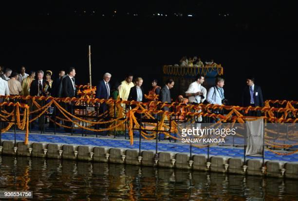 German President FrankWalter Steinmeier arrives ahead of an evening 'Aarti' ritual at Dasaswamedh Ghat on the banks of the River Ganges at Varanasi...