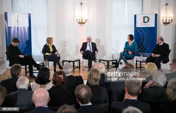 German President FrankWalter Steinmeier British author Salman Rushdie Austrian author Eva Menasse and AustrianGerman author Daniel Kehlmann listen to...