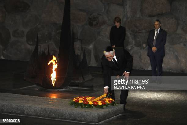 German President FrankWalter Steinmeier escorted by his wife Elke Budenbender and the chairman of the Yad Vashem Holocaust Memorial museum Avner...