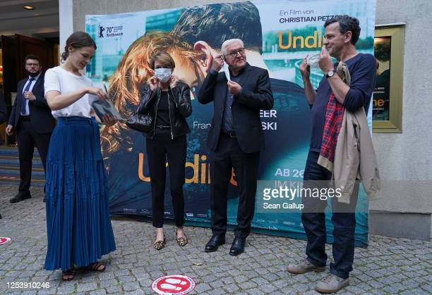 German President Frank-Walter Steinmeier , First Lady Elke Buedenbender , actress Paula Beer and director Christian Petzold don protective face masks...