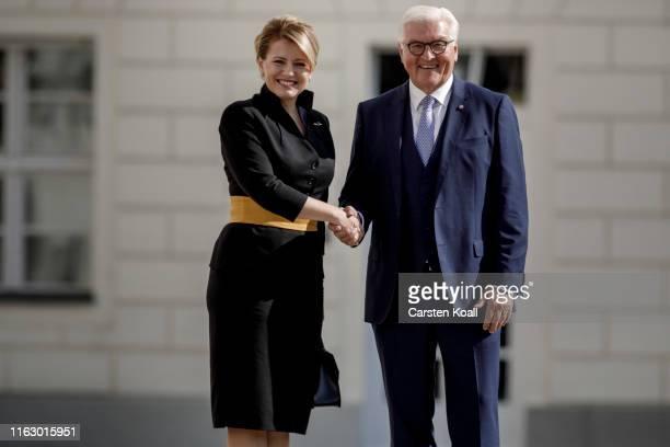German President FrankWalter Steinmeier greets new Slovak President Zuzana Caputova upon Caputova's arrival at Schloss Bellevue on August 21 2019 in...
