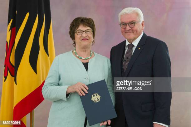 German President FrankWalter Steinmeier hands over the certificates of discharge to German Economy Minister Brigitte Zypries at the Bellevue...