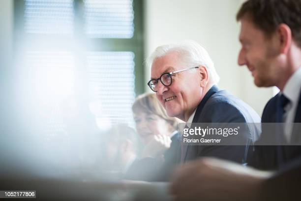 German President FrankWalter Steinmeier his wife Elke Buedenbender and Prime Minister of the German State of Saxony Michael Kretschmer are pictured...