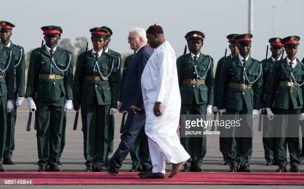 German President Frank-Walter Steinmeier is bidden farewell with military honours by the president of the Republic of The Gambia, Adama Barrow, at...