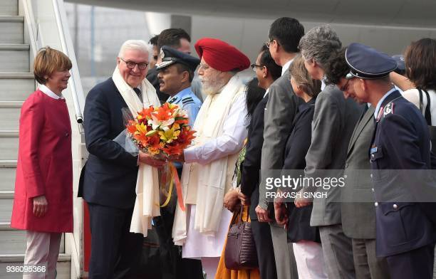 German President FrankWalter Steinmeier is welcomed by SS Ahluwalia Indian Minster of State for Drinking Water and Sanitation as his wife Elke...