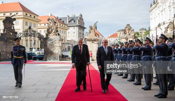 German President FrankWalter Steinmeier is welcomed by the President of the Czech Republic Milo· Zeman with military honours at the Prague Castle in...