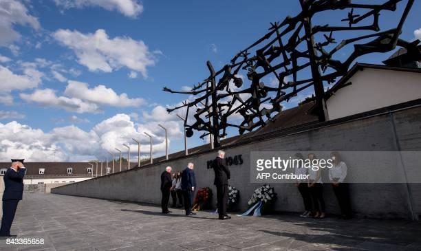 German President FrankWalter Steinmeier Israeli President Reuven Rivlin and Bavarian State Premier Horst Seehofer pay their respect at the...