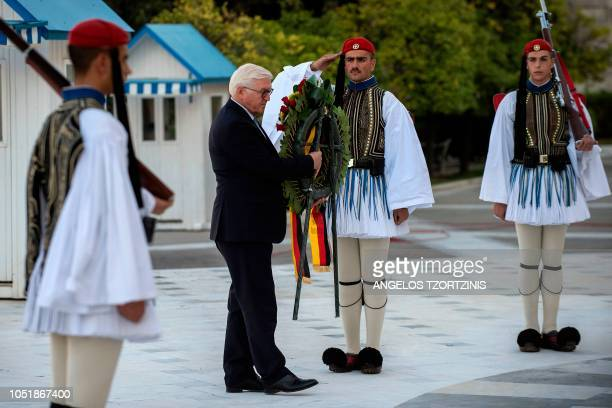 German President FrankWalter Steinmeier lays a wreath at the Tomb of the Unknown Soldier in Athens on October 11 during a twoday official visit