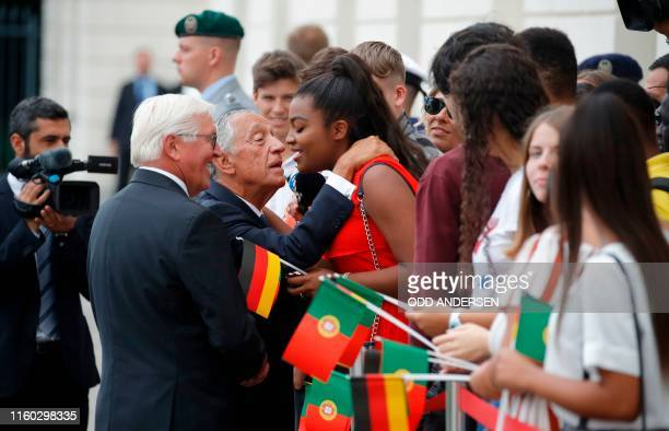 German President FrankWalter Steinmeier looks on as his Portuguese counterpart Marcelo Rebelo de Sousa greets a wellwisher during a welcoming...
