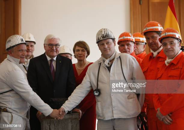 German President Frank-Walter Steinmeier poses with his wife Elke Buedenbender as he receives a symbolic final chunk of coal by German Coal miners in...