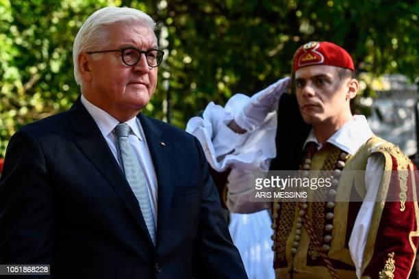 German President FrankWalter Steinmeier reviews the Greek Presidential guard before their meeting in Athens on October 11 2018 Steinmeier is in...