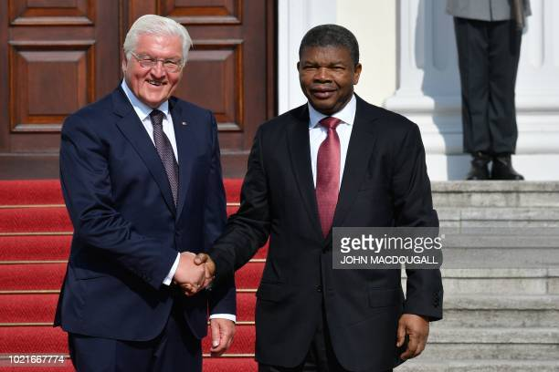 German President FrankWalter Steinmeier shakes hands with Angolan President Joao Lourenco as he welcomes him in front of the Schloss Bellevue...