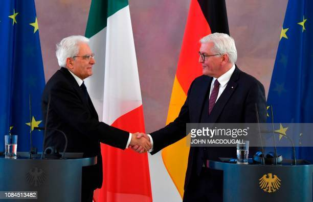 German President Frank-Walter Steinmeier shakes hands with Italy's President Sergio Mattarella during a visit at the presidential Bellevue Palace in...