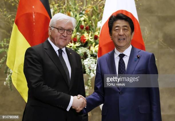 German President FrankWalter Steinmeier shakes hands with Japan's Prime Minister Shinzo Abe at Abe's official residence in Tokyo on February 6 2018...