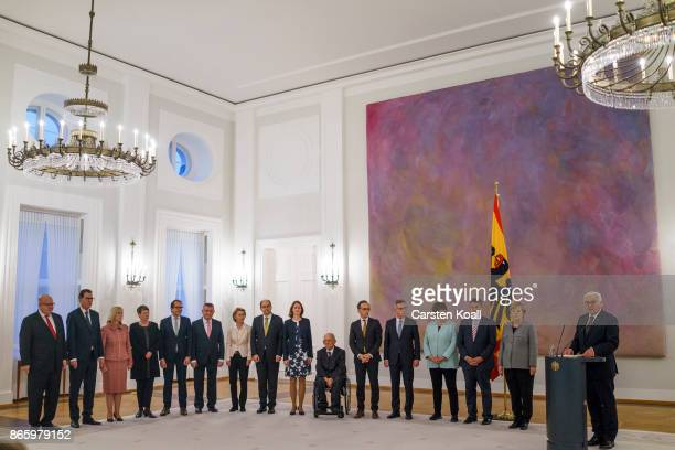 German President Frank-Walter Steinmeier speaks next to German Chancellor Angela Merkel and Vice Chancellor and German Foreign Minister Siegmar...