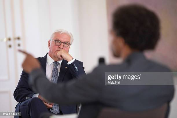 """German President Frank-Walter Steinmeier speaks with Daniel Gyamerah division manager of Think-Tanks """"Citizens For Europe"""" in Berlin while hosting a..."""