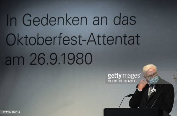 German President FrankWalter Steinmeier takes off his face mask before speaking at 40th anniversary memorial of the Oktoberfest attack in Munich on...