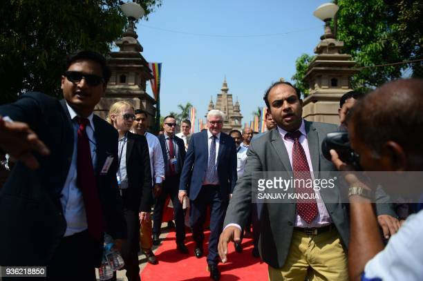 TOPSHOT German President FrankWalter Steinmeier walks with an entourage after visiting the Mulagandhakuti Vihara Temple at the Dhamekh Buddhist Stupa...