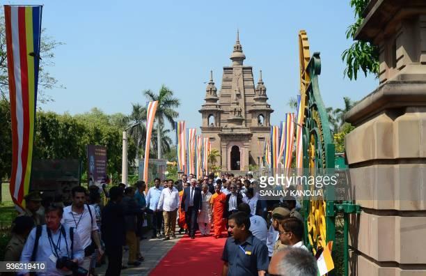 German President FrankWalter Steinmeier walks with an entourage after visiting the Mulagandhakuti Vihara Temple at the Dhamekh Buddhist Stupa in...
