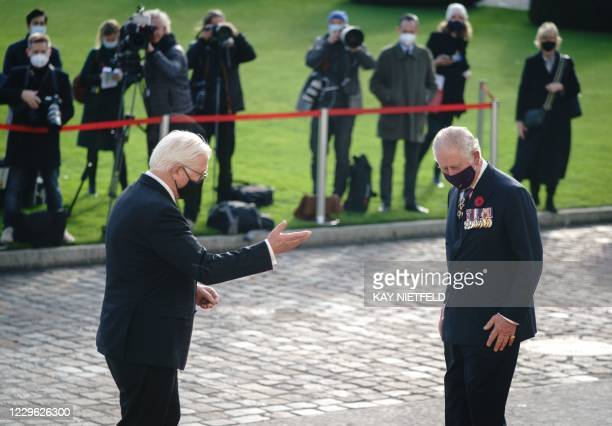 German President Frank-Walter Steinmeier welcomes Britain's Prince Charles, Prince of Wales at his arrival at the presidential Bellevue palace in...