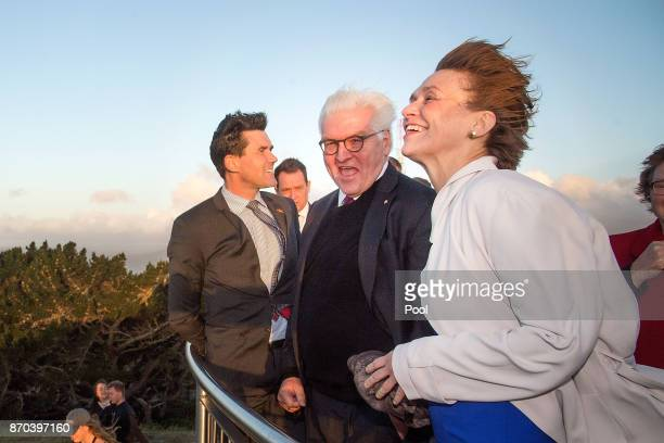 German President FrankWalter Steinmeier with his wife Elke Budenbender and Mayor of Wellington City Justin Lester are hit by the Wellington wind at...