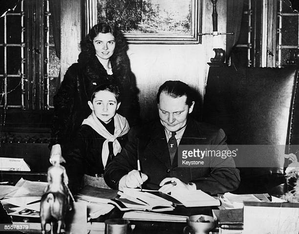 German President Hermann Goering signs a photograph of himself for Leone Re a member of the Italian Opera Nazionale Balilla and son of a highranking...