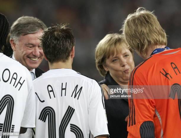 German president Horst Köhler an femal chacellor Angela Merkel congratulate the german team member Philipp Lahm and Oliver Kahn Germany won the 3rd...