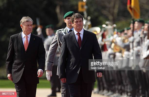 German President Horst Koehler and Albanian President Bamir Topi review a guard of honour upon Topi's arrival at Bellevue Palace on April 6 2010 in...