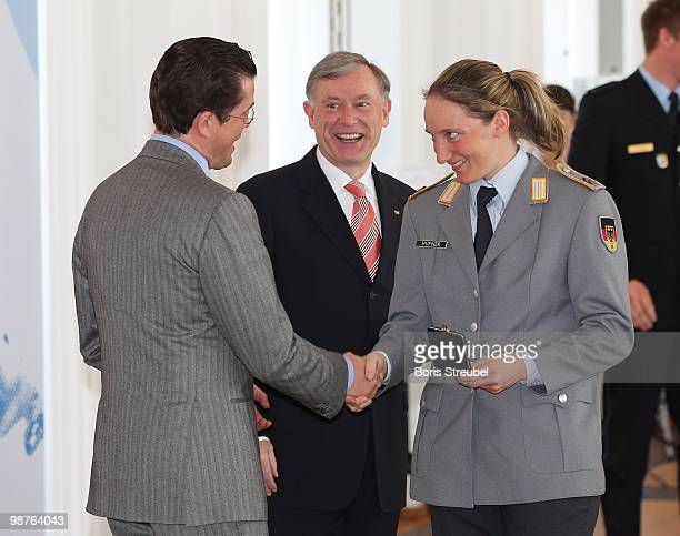 German President Horst Koehler and German Defense Minister KarlTheodor zu Guttenberg awards bobsled driver Tatjana Huefner at the Silbernes...