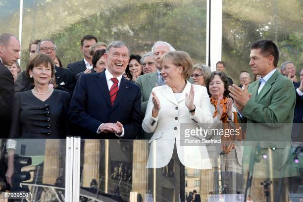 German President Horst Koehler and his wife Eva Luise Koehler and German Chancellor Angela Merkel and her husband Joachim Sauer attend the...