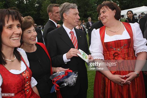 German President Horst Koehler and his wife Eva Luise Koehler chat with two women from Bavaria at the annual summer party hosted by Koehler at...