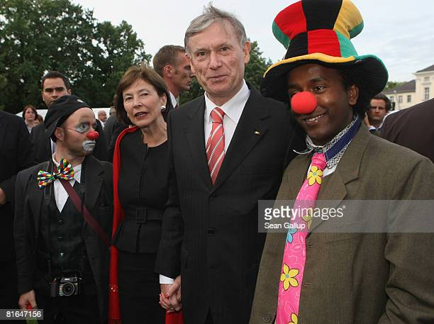 German President Horst Koehler and his wife Eva Luise Koehler pose with clowns at the annual summer party hosted by Koehler at Schloss Bellevue...