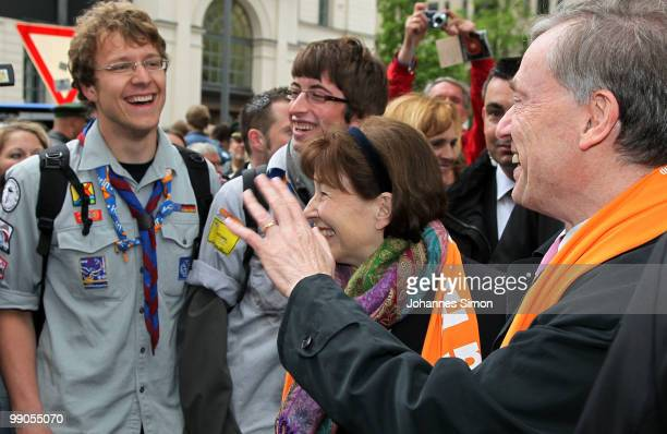 German President Horst Koehler and his wife Eva Luise waves to Christian boy scouts during day 1 of the 2nd Ecumenical Church Day at Marienplatz...