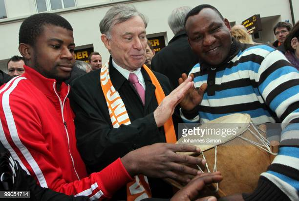 German President Horst Koehler beats the drum with African guests during day 1 of the 2nd Ecumenical Church Day at Marienplatz square on May 12 2010...