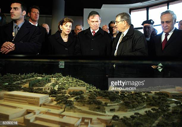 German President Horst Koehler flanked by his wife Eva and a guide to the Yad Vashem Holocaust Memorial pauses to view a model of the complex as he...