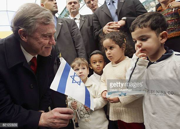 German President Horst Koehler greets a young Jewish boy as he talks with the kindergarten children on February 2 2005 in Sderot Israel Koehler is on...
