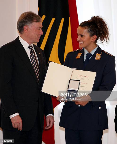 German President Horst Koehler hands over the Silver Laurel Leaf to Fatmire Bajramaj, member of the Womens German National football team, at Bellevue...