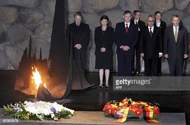 German President Horst Koehler his wife Eva and his Israeli counterpart Moshe Katzav stand next to unidentified officials after Koehler laid a wreath...