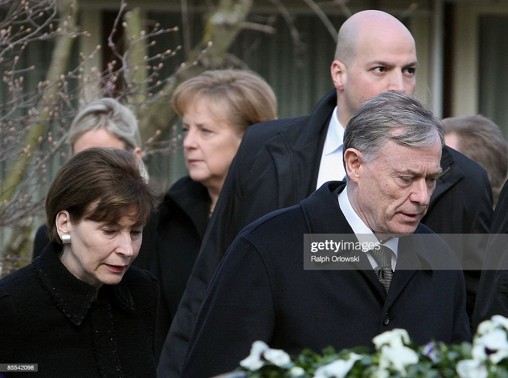 German president Horst Koehler (R), his wife Eva Luise (L) and German chancellor Angela Merkel (back) arrive for a memorial service at the Sankt Karl Barromaeus church on March 21, 2009 in Winnenden near Stuttgart, Germany. President Koehler, Chancellor Merkel and thousands of mourners hold a memorial ceremony to commemorate the victims of a school shooting. 17 - year old Tim Kretschmer opened fire on Wednesday, March 11, 2009 on teachers and pupils at his former school, killing 15 people and leaving many more injured. Kretschmer fled the scene and shot himself dead after being cornered by police.