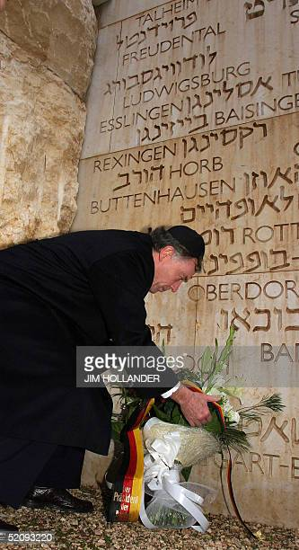 German President Horst Koehler lays a wreath at the Valley of the Communities in the Yad Vashem Holocaust memorial complex in Jerusalem 01 February...